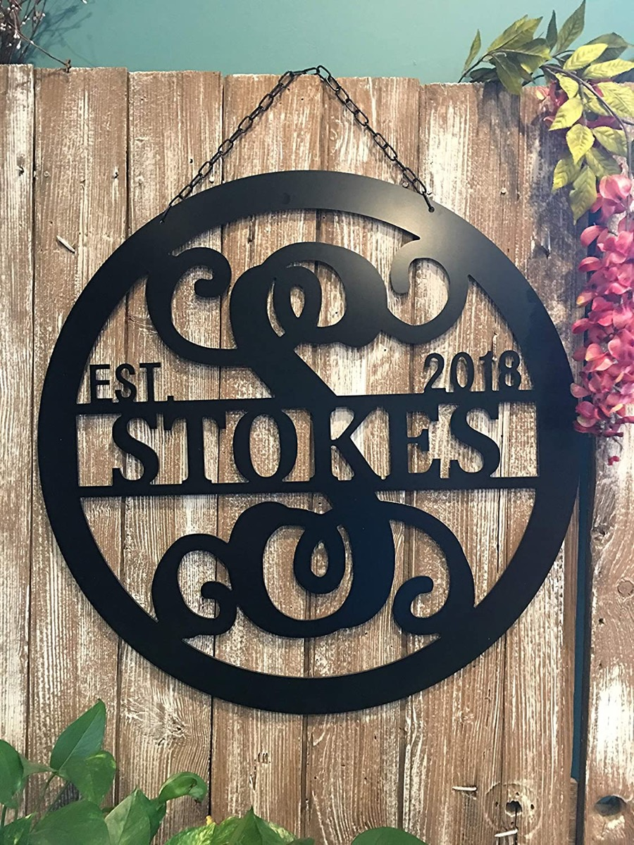 "black home sign reading ""stokes est 2018"""