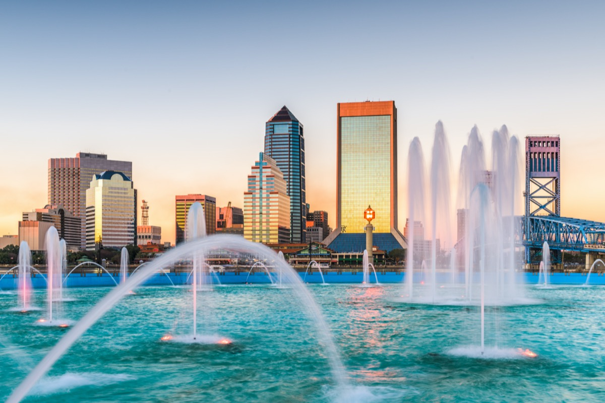 cityscape photo of fountain, buildings, and bridge in downtown Jacksonville, Florida