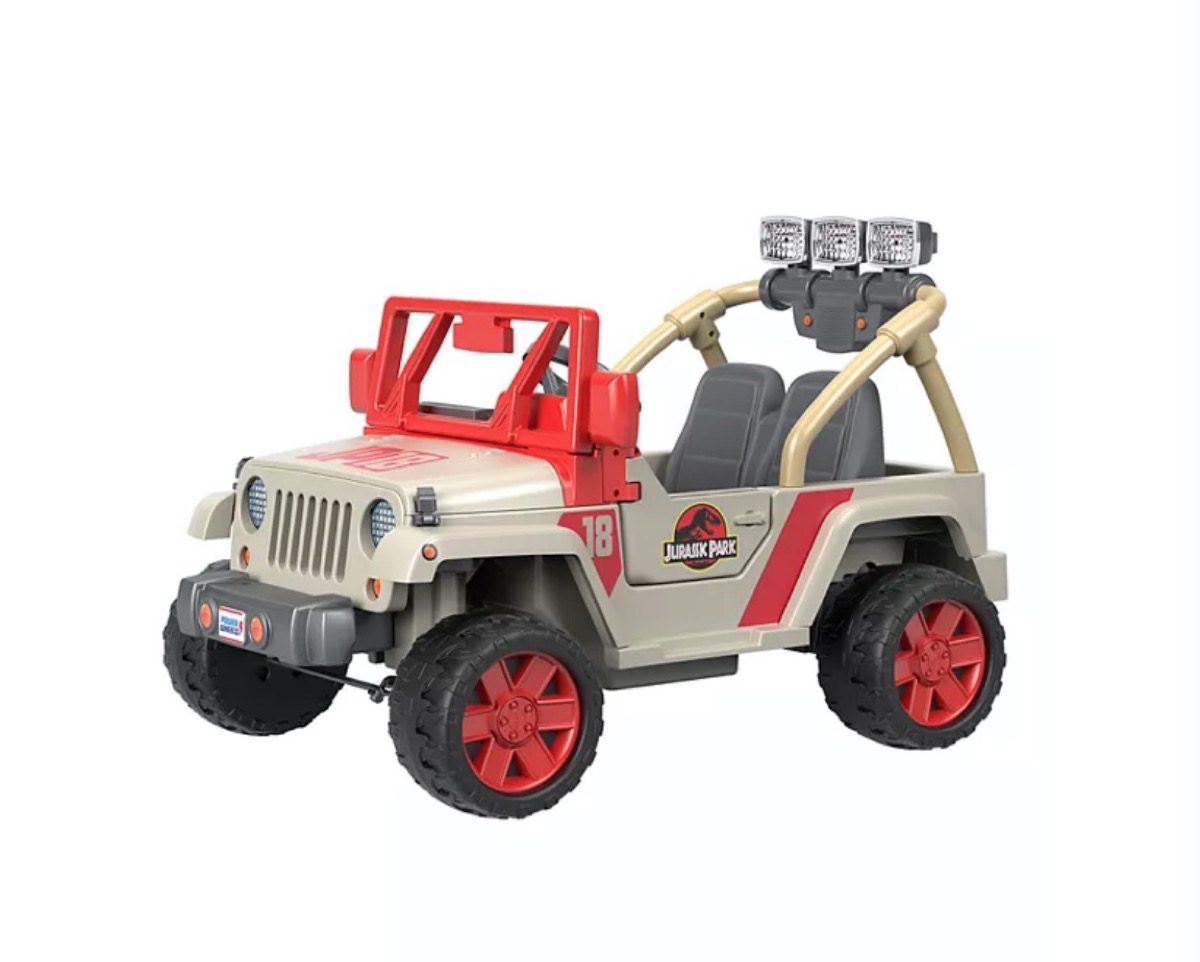 beige and red ride-on toy that looks like jeep