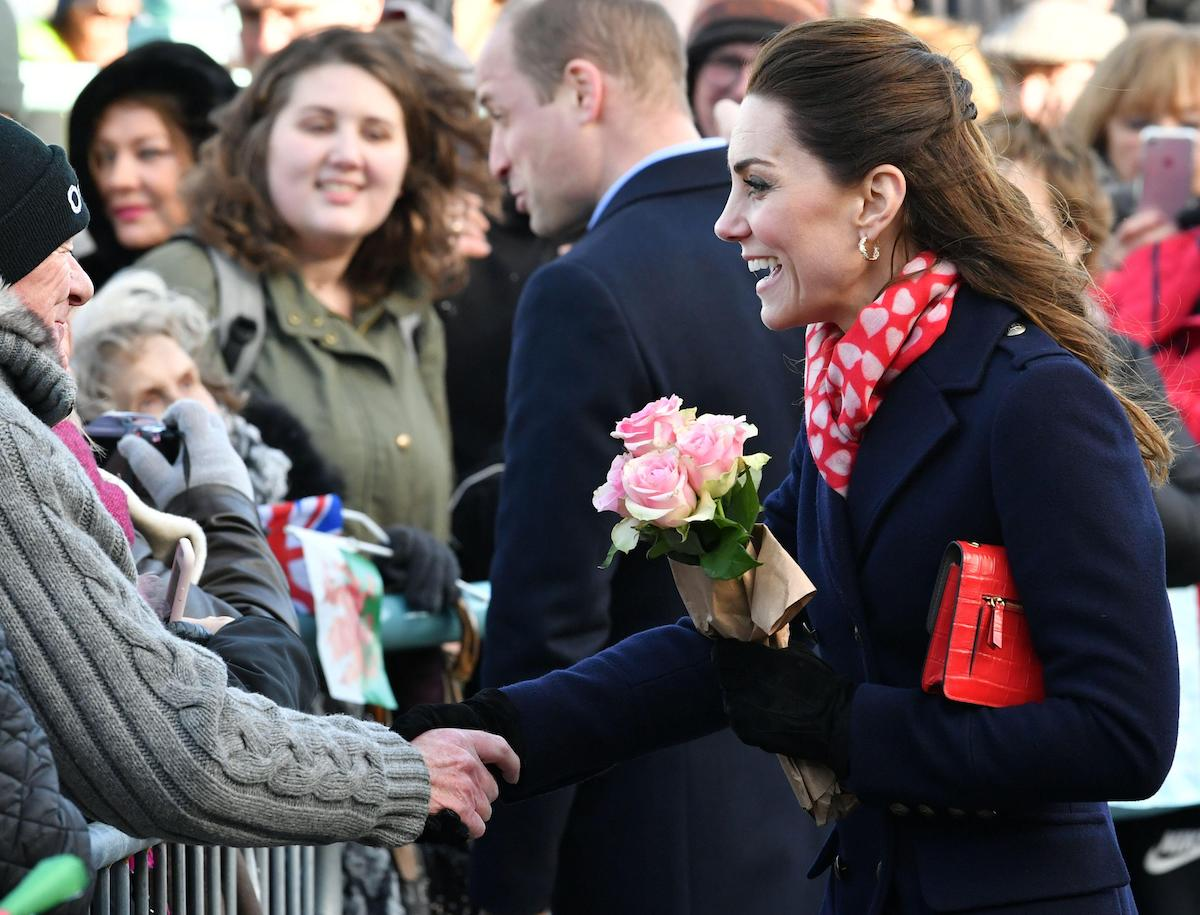 Kate Middleton, Duchess of Cambridge speaks to people in the crowd as she leaves the RNLI Mumbles Lifeboat Station, near Swansea in south Wales, Britain February 4, 2020.