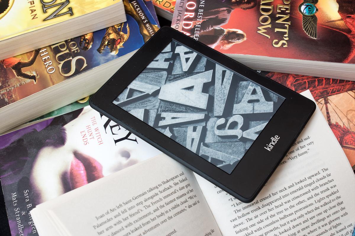 Amazon Kindle e book reader on the pile of books