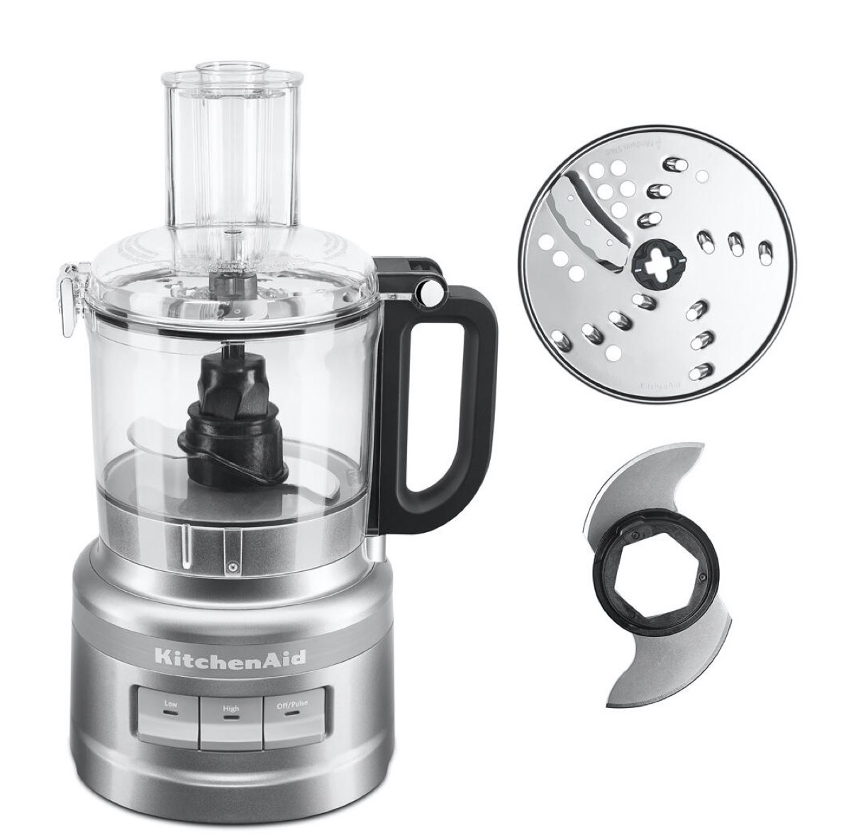 silver kitchenaid food processor next to shredding disc and blade attachment