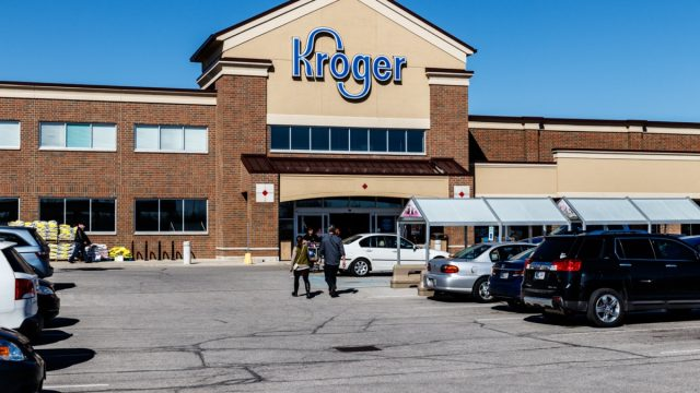 the entrance of and parking lot in front of a Kroger retail store in Indianapolis, Indiana