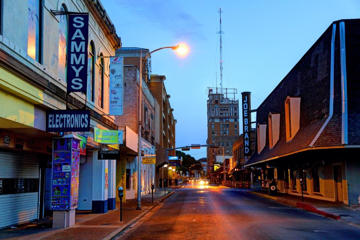 street in downtown Laredo, Texas at night