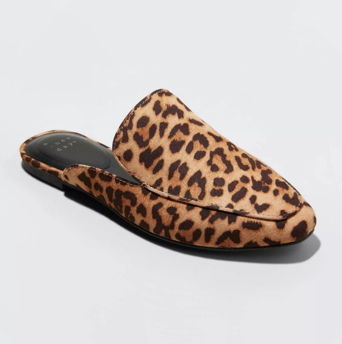 leopard print slide shoes on white background