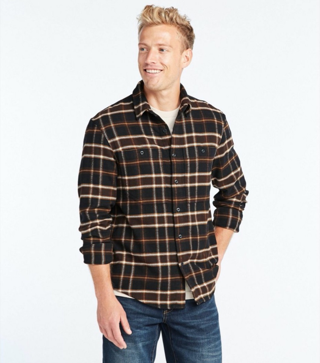 young man in brown and black plaid shirt and jeans