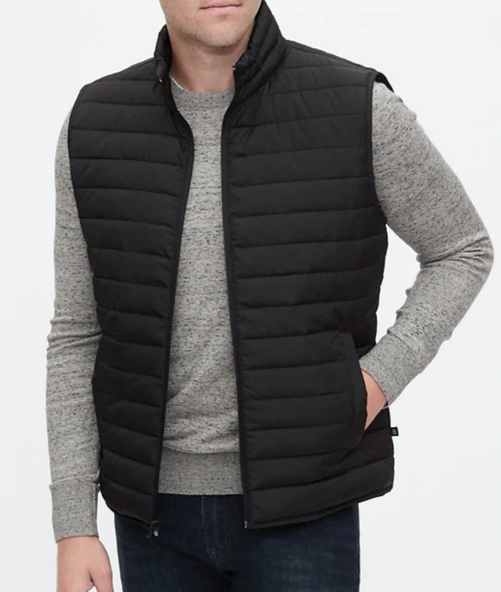 man in gray shirt and black puffer vest