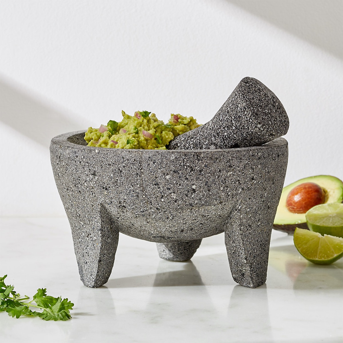 mortar and pestle with guacamole in it