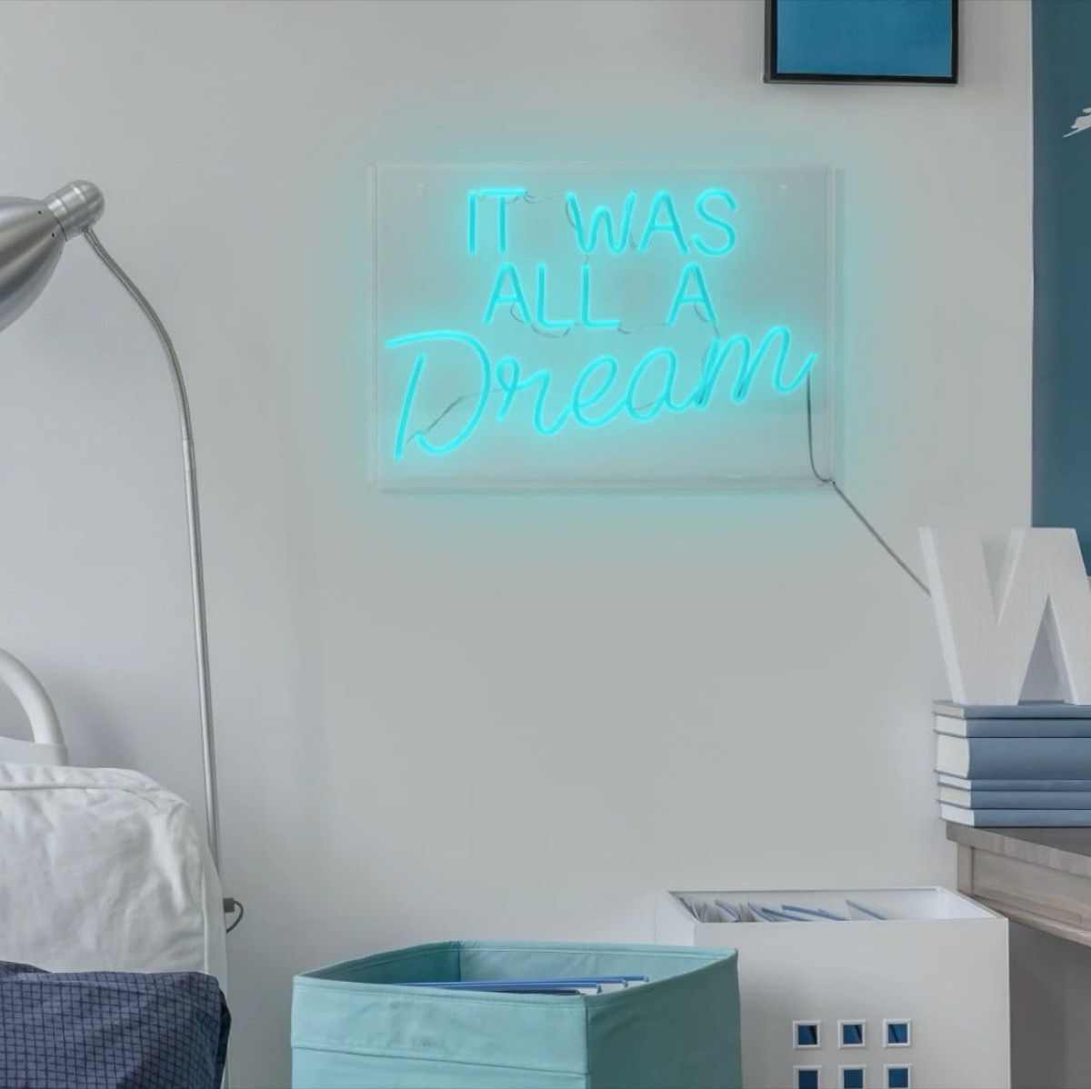 """green neon sign reading """"It was all a dream"""""""