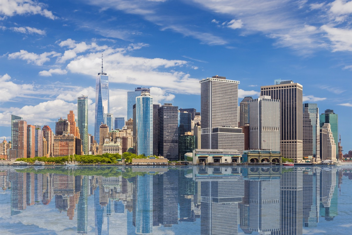 city skyline of and Water of New York Harbor in New York, NY