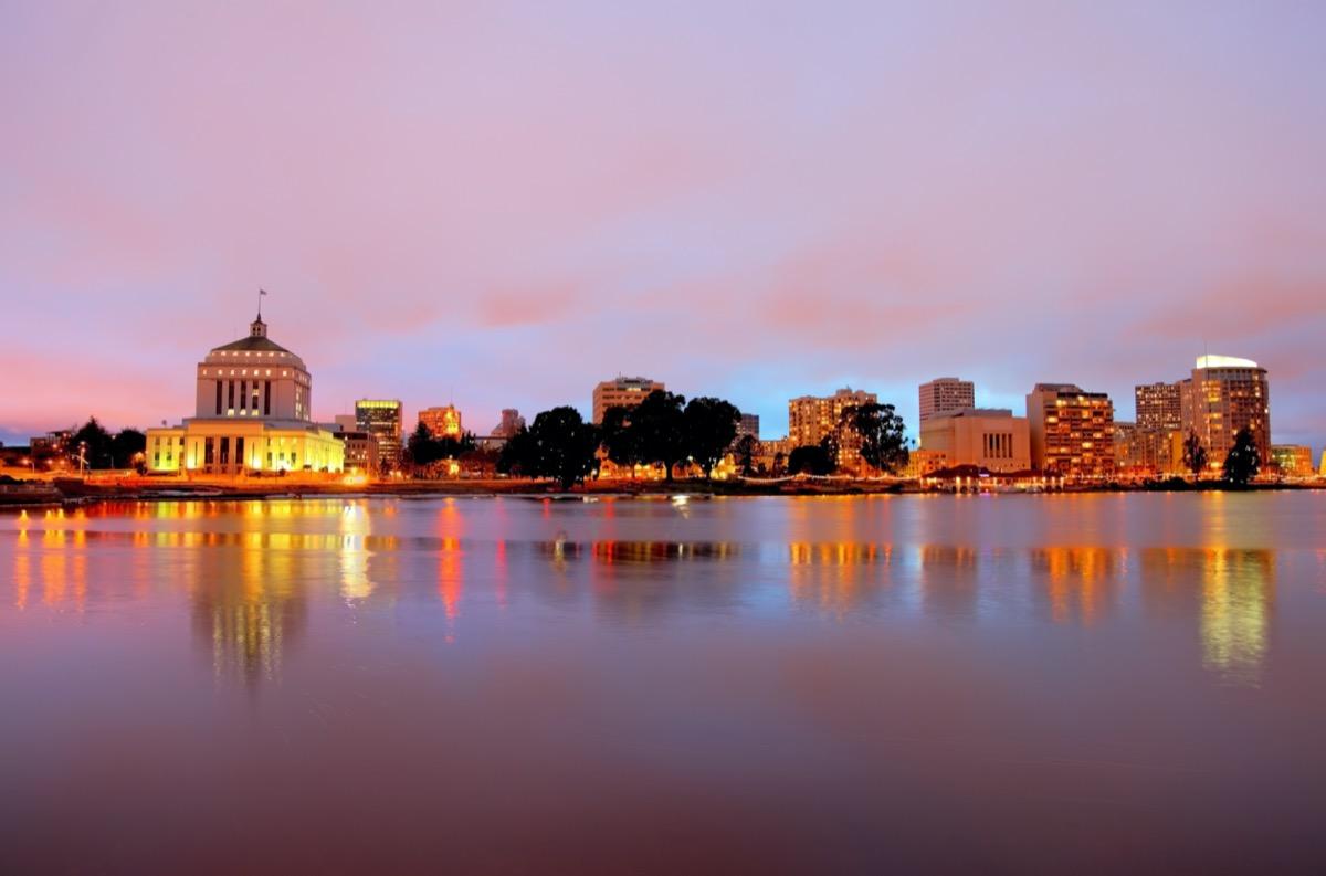 city skyline of and Lake Merritt in Oakland, California at dusk