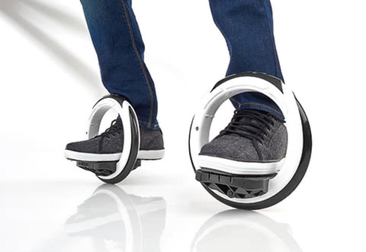 gray sneakers inside of white motorized wheels
