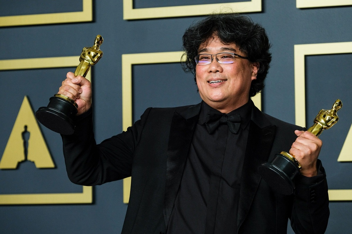 Bong Jon Ho poses with his Oscars after winning award for film 'Parasite' in February 2020