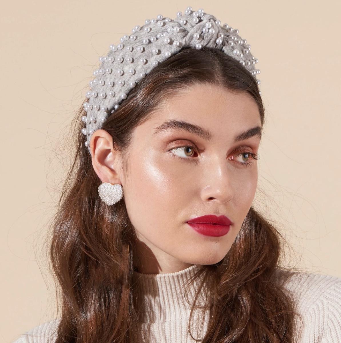 woman wearing gray headband with pearls