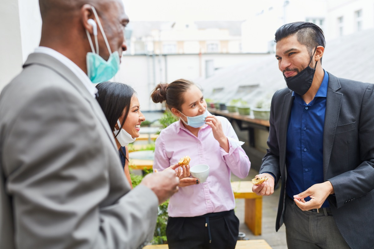 group of 30-something friends gathering with their masks down