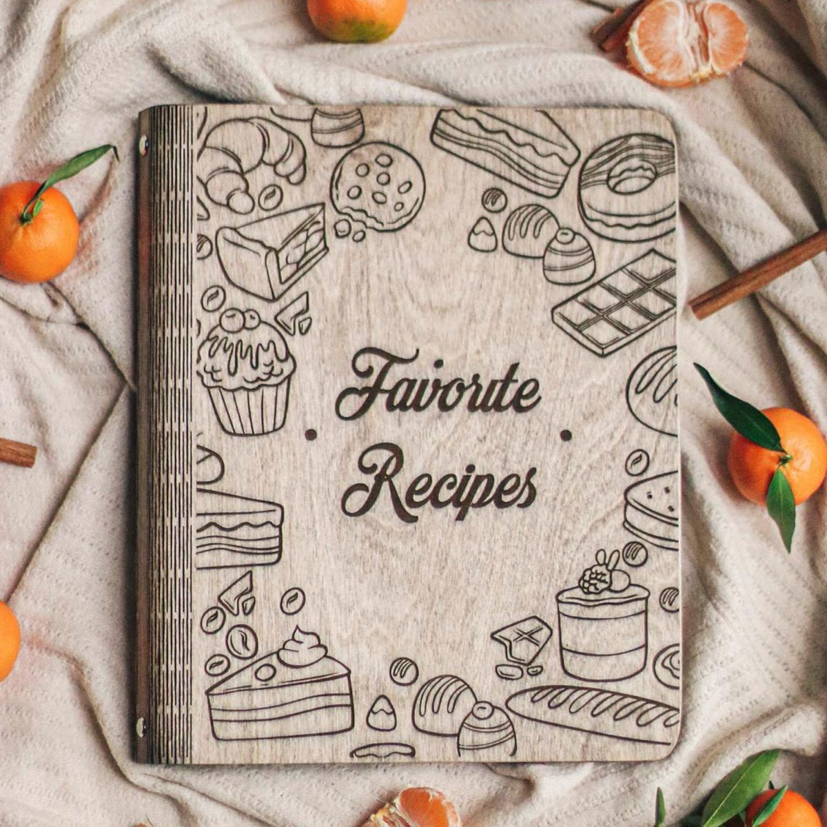"""book with wooden cover reading """"favorite recipes"""""""
