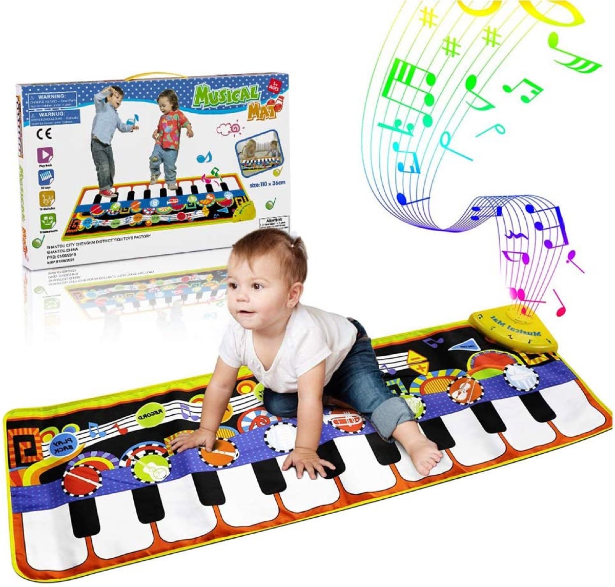 infant crawling on toy piano floor mat