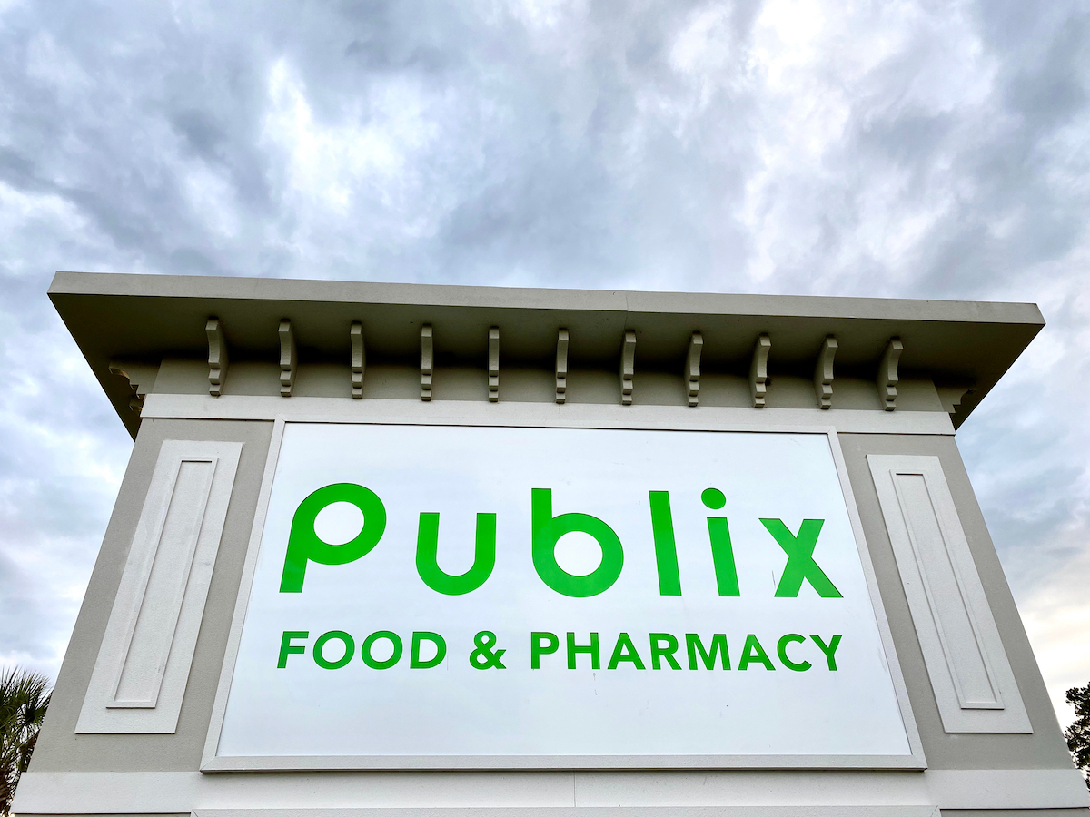 Upward view of Publix supermarkets road sign in Richmond Hill, Georgia