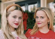 reese witherspoon and ava phillippe pose in matching draper james holiday sweaters
