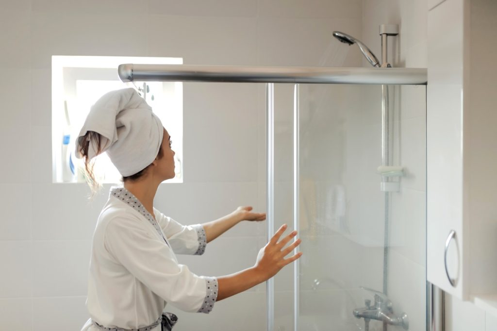 Young Woman in Bath Robe Getting Ready to Shower in the Bathroom at Home