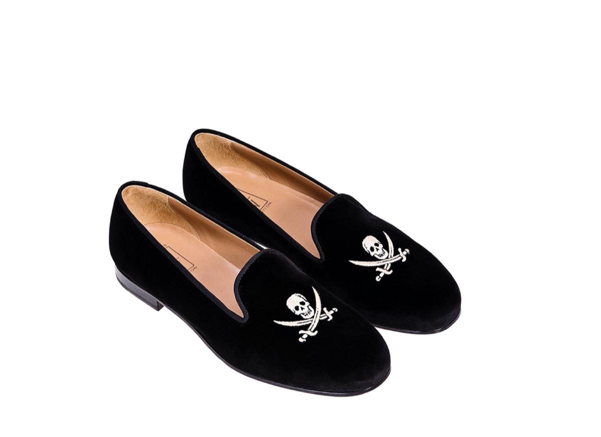 black velvet shoes with white skulls