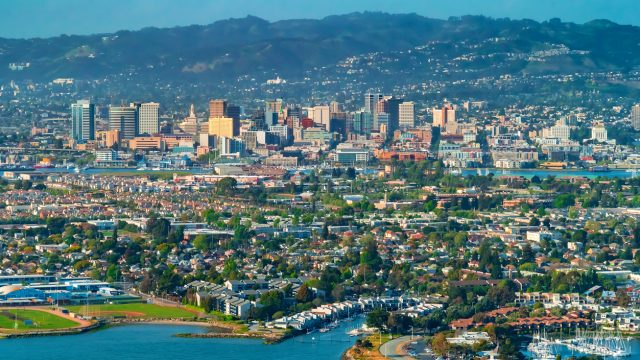 The skyline of Oakland, California from the bay.
