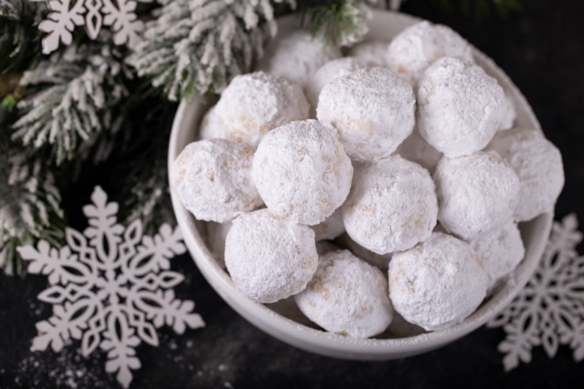 snowball cookies in white bowl on table