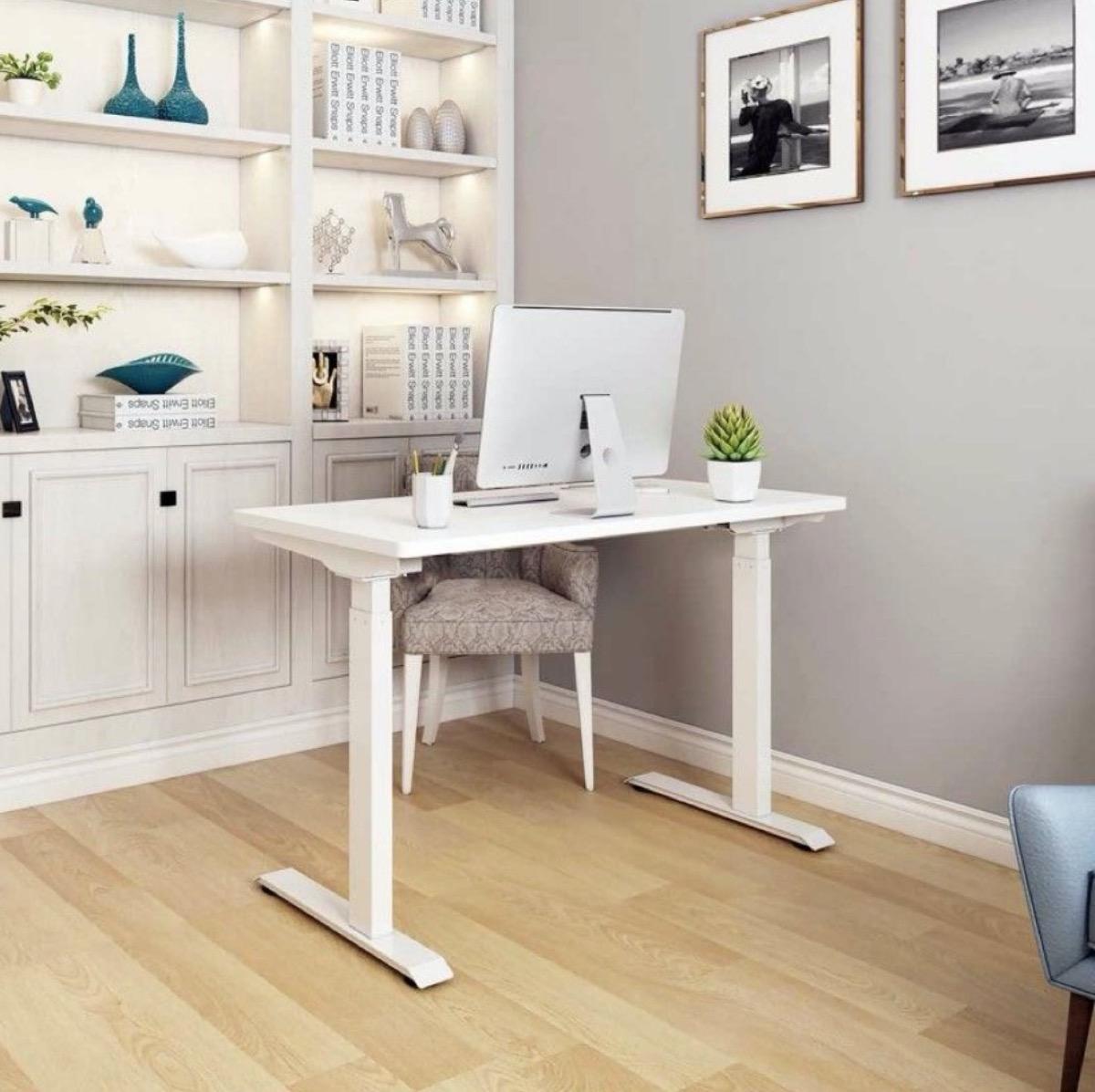 white standing desk in office