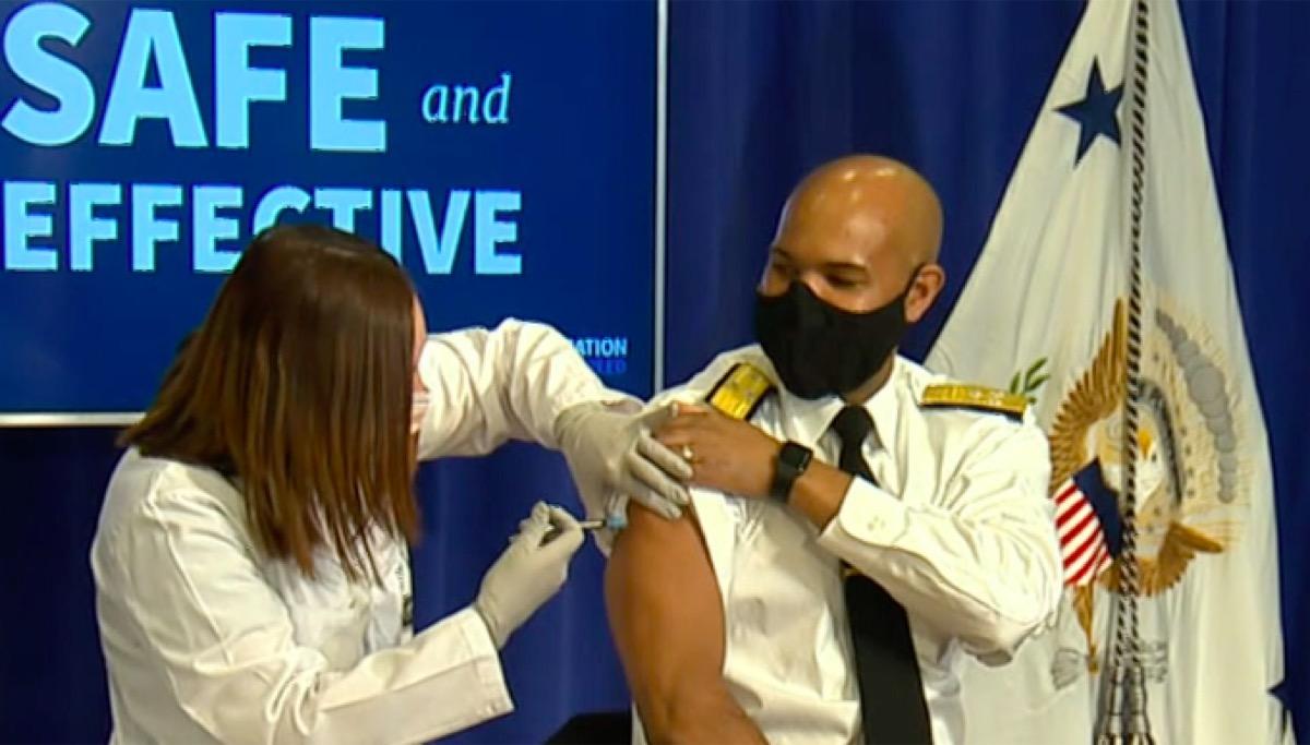 Surgeon General Jerome Adams getting COVID vaccine