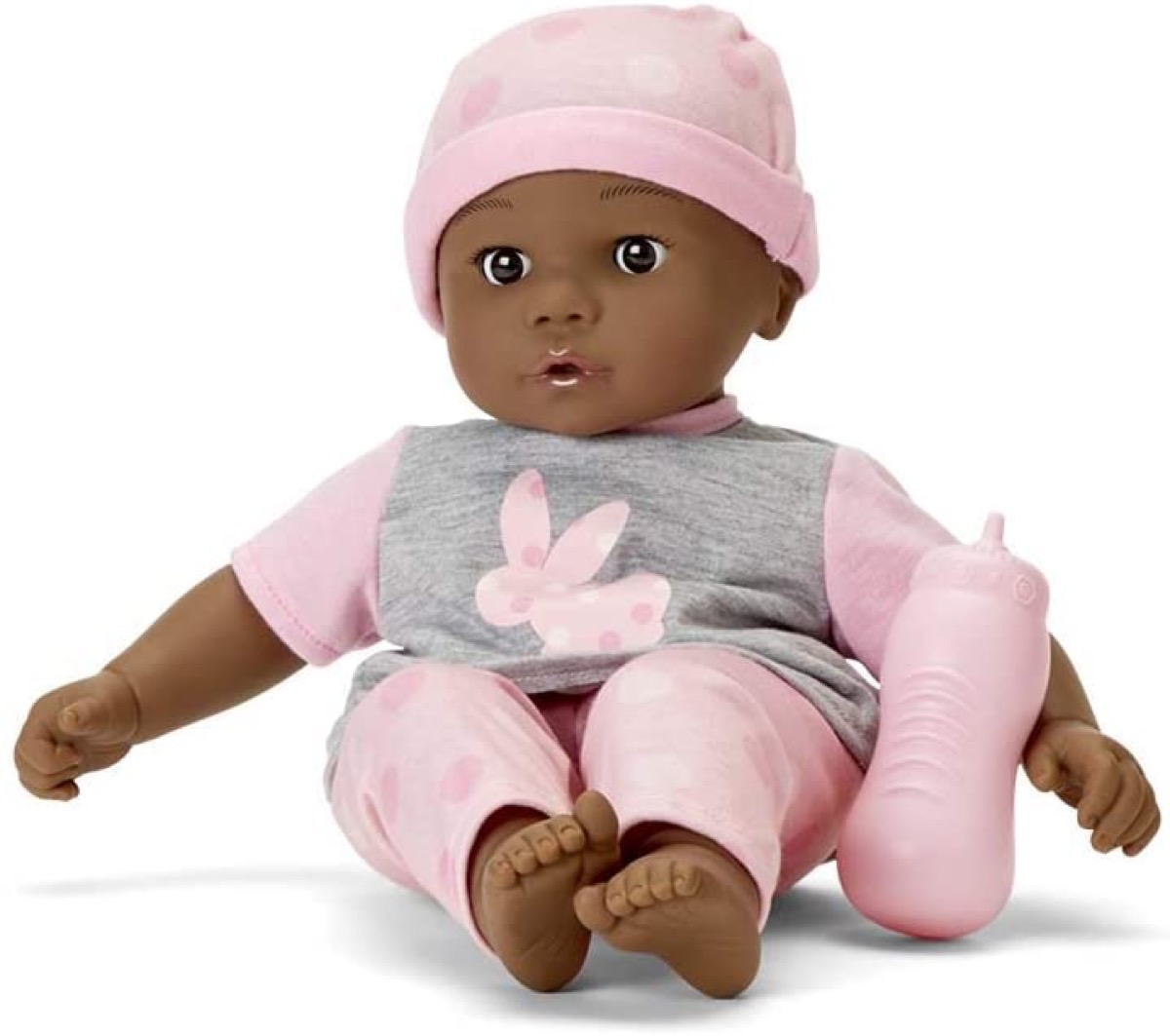 baby doll in pink and gray outfit with pink baby bottle
