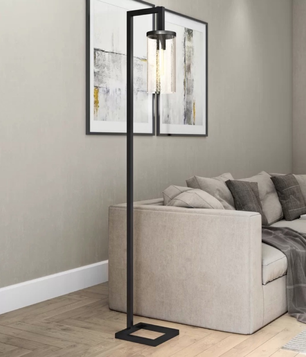 black floor lamp next to gray couch