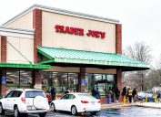people lined up outside a trader joe's store