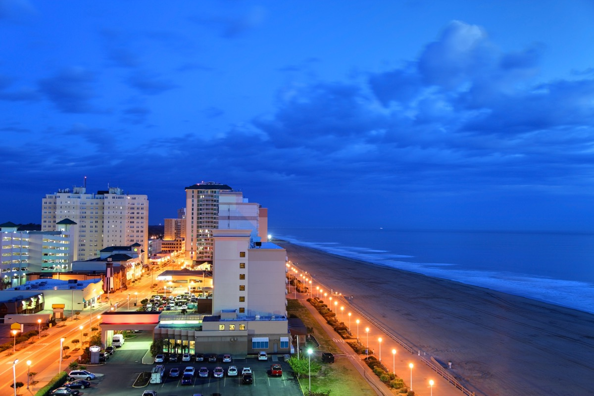 ocean front and buildings in downtown Virginia Beach, Virginia at dusk