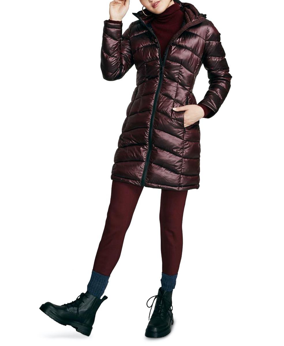 woman in hip-length purple or brown puffer coat