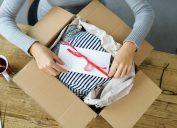woman opening gift in cardboard box