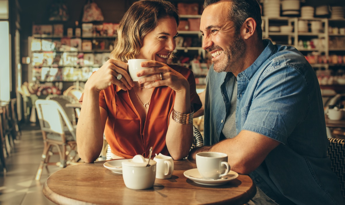Man and woman sitting close in coffeeshop