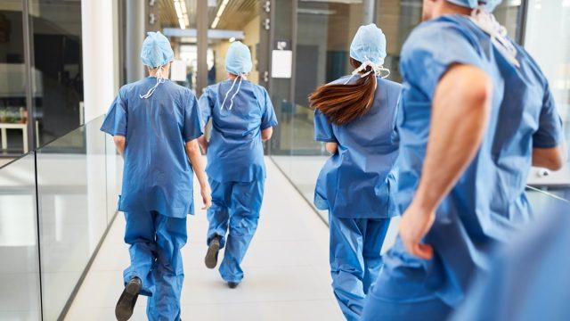 Four doctors running to ER