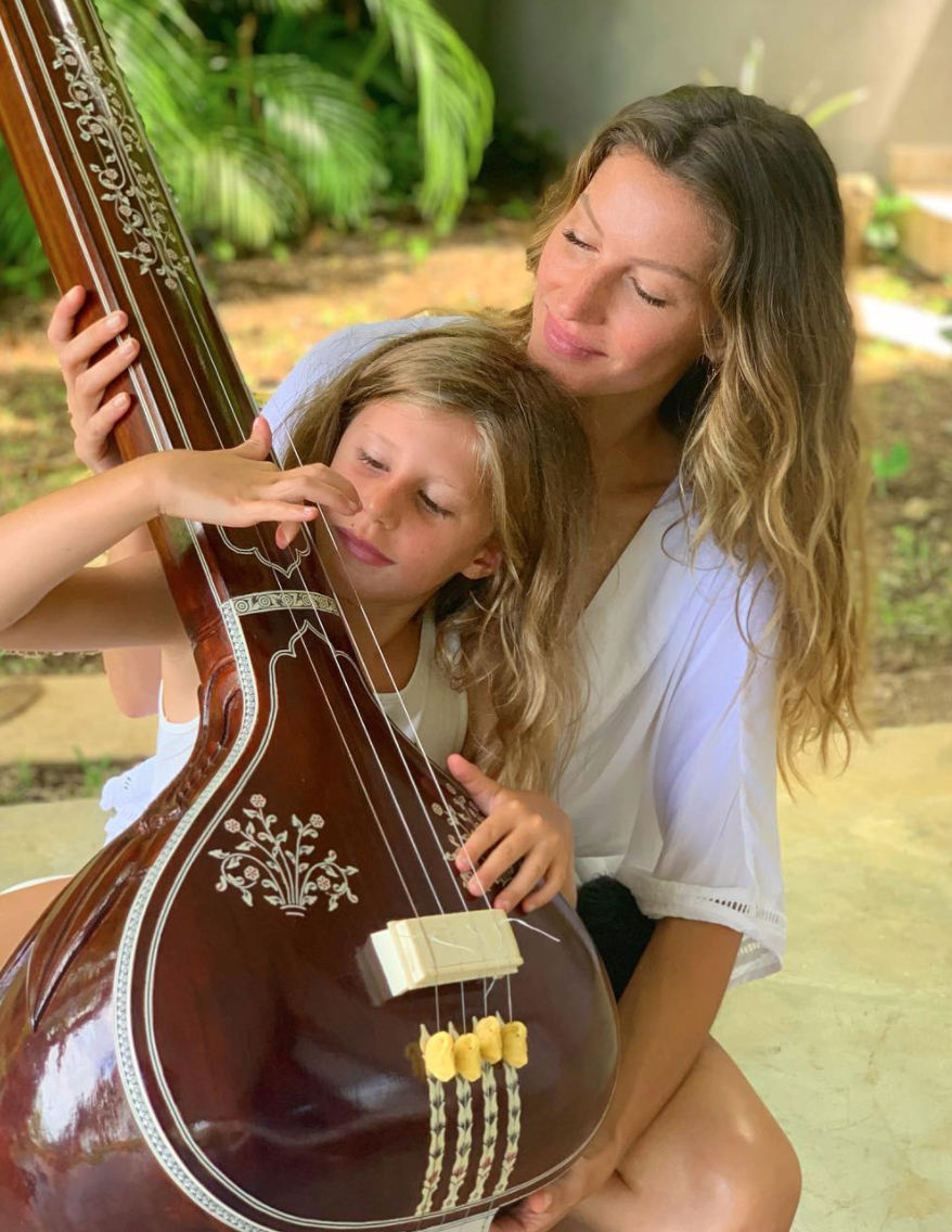 Gisele Bundchen and Vivian with instrument