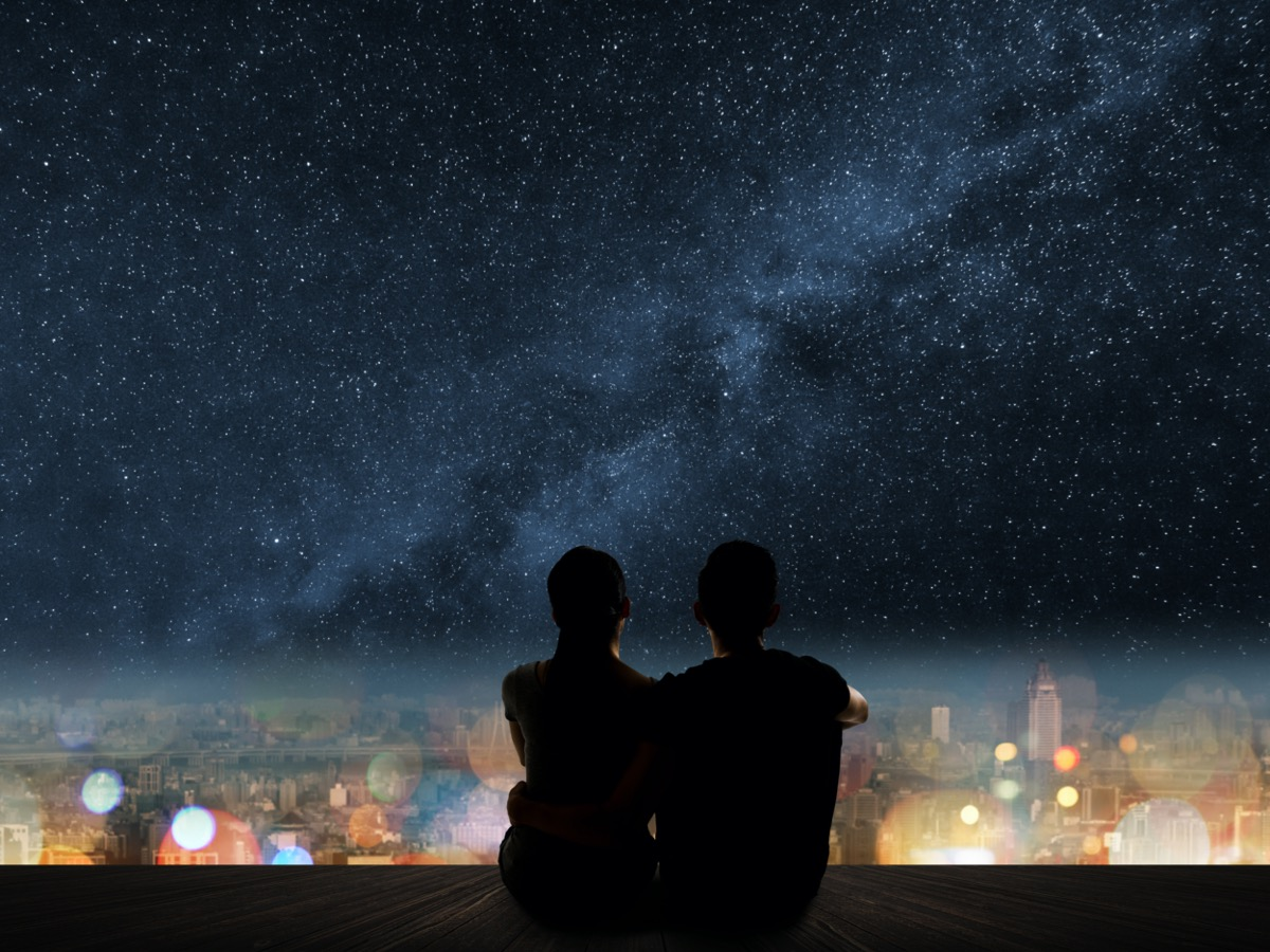 Man and woman looking at starry sky