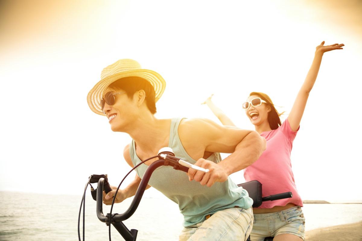Man and woman riding tandem bike