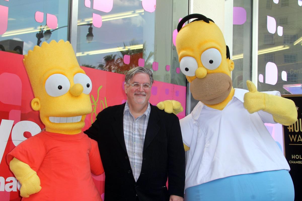 Matt Groening with Homer and Bart Simpson