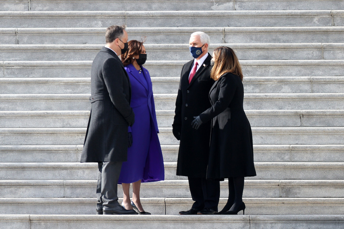 U.S. Vice President Kamala Harris and Second Gentleman Douglas Emhoff speak with former U.S. Vice President Mike Pence and former Second Lady Karen Pence on the steps of the East Front of the U.S. Capitol following the inauguration of U.S. President Joe Biden on January 20, 2021 in Washington, DC