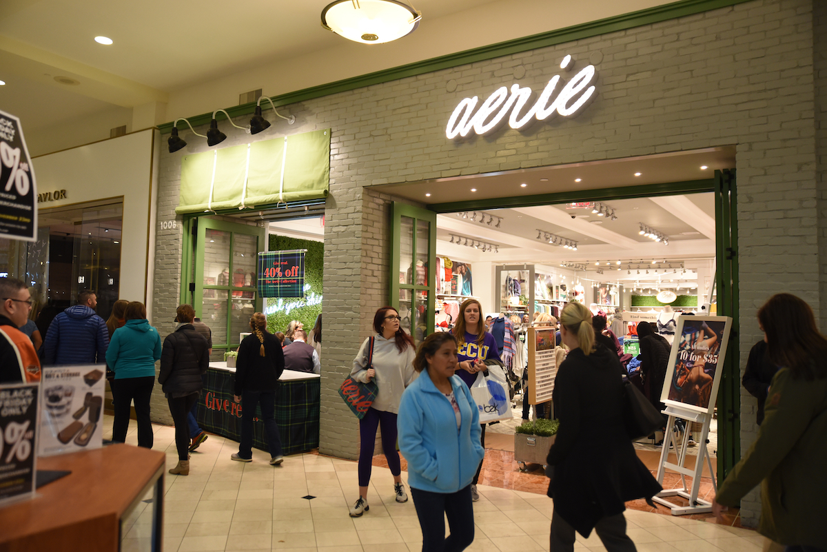 Mall shoppers hunt for discounted apparel at Aerie on Black Friday.