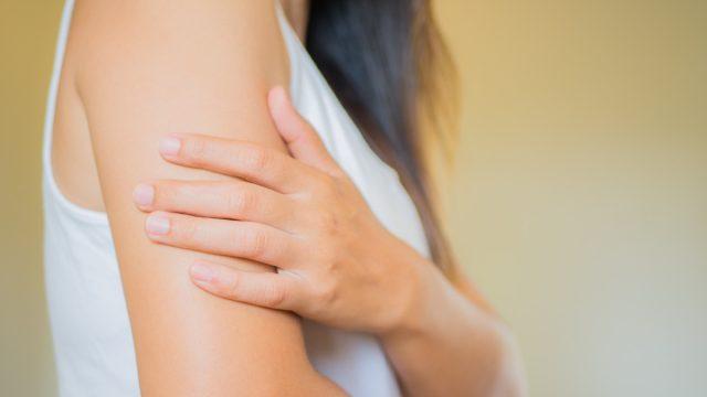 Woman examining arm