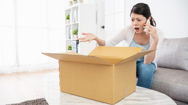 Woman is talking to the online customer service, she is unsatisfied with her parcel and complaining with them