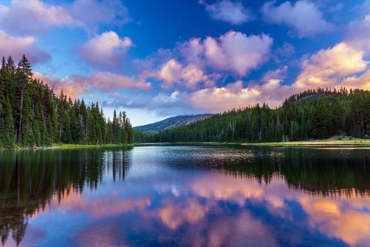 landscape photo of Mt. Bachelor reflecting in Todd Lake in Bend, Oregon at dusk