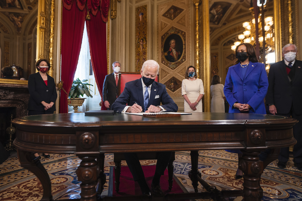 President Joe Biden signs three documents including an Inauguration declaration, cabinet nominations and sub-cabinet nominations, as US Vice President Kamala Harris (R) watches in the Presidents Room at the US Capitol after the inauguration ceremony making Biden the 46th President of the United States on January 20, 2021 in Washington, DC.