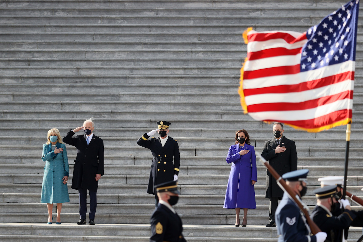 President Joe Biden, first lady Dr. Jill Biden, Vice President Kamala Harris and second gentleman Doug Emhoff attend a Pass in Review ceremony, hosted by the Joint Task Force-National Capital Region on the East Front of the U.S. Capitol after the Presidential Inauguration on January 20, 2021 in Washington, DC.