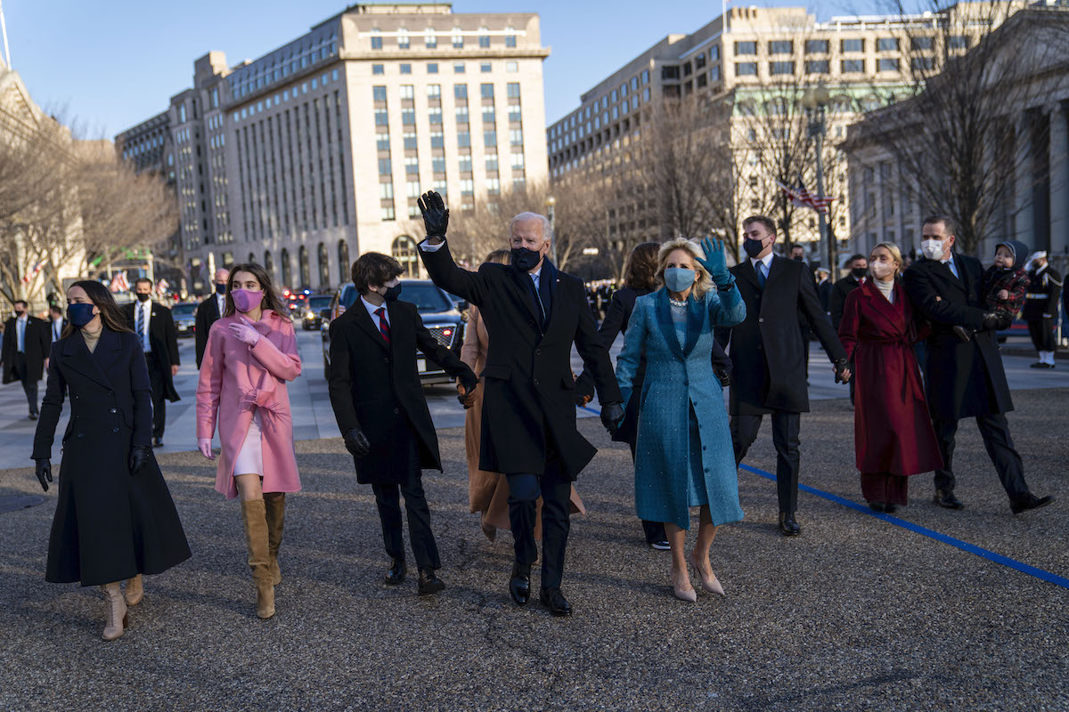 President Joe Biden and First Lady Dr. Jill Biden walk along Pennsylvania Avenue in front of the White House during Inaugural celebrations, Wednesday, Jan. 20, 2021.