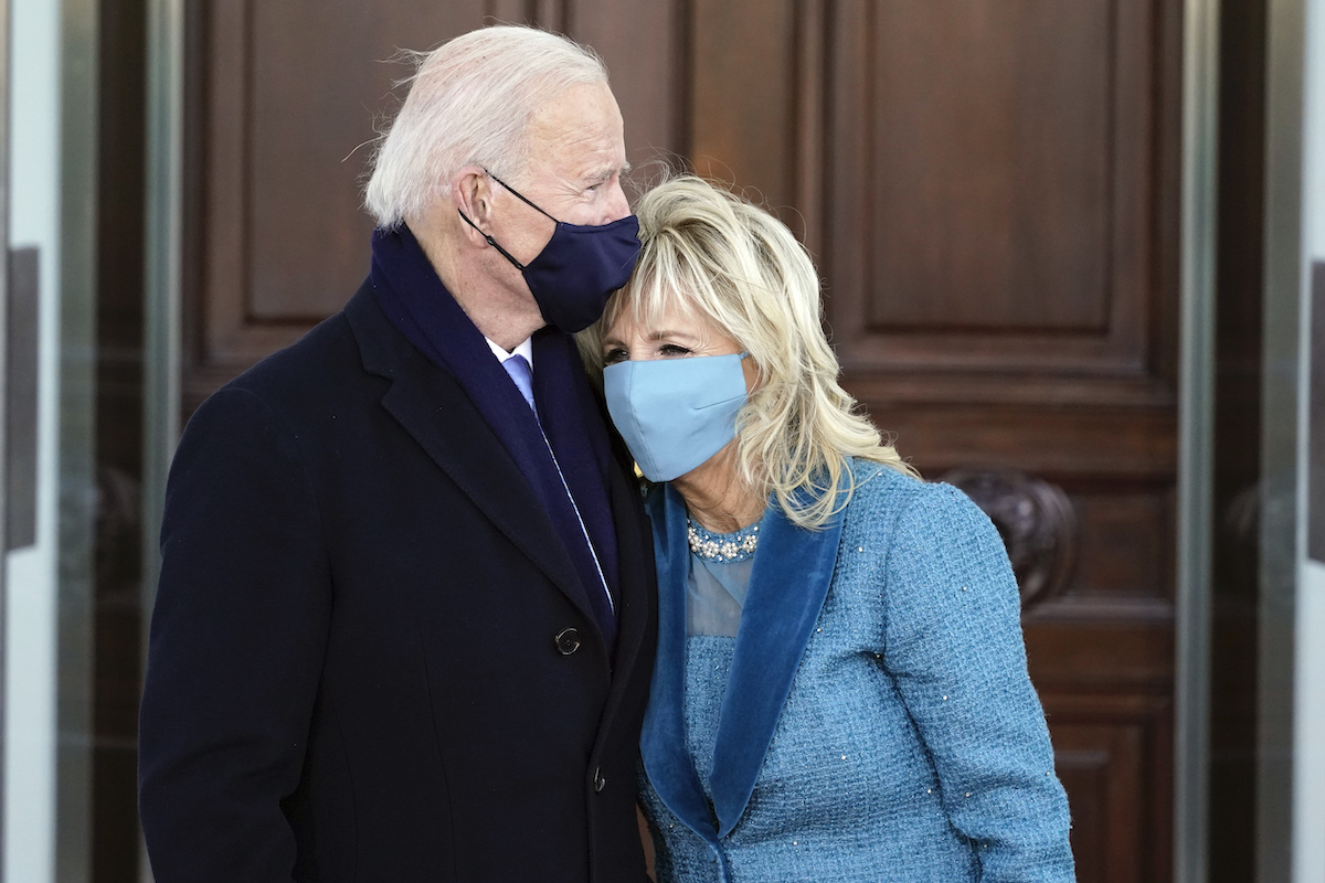 President Joe Biden and first lady Dr. Jill Biden hug as they arrive at the North Portico of the White House, on January 20, 2021, in Washington, DC.